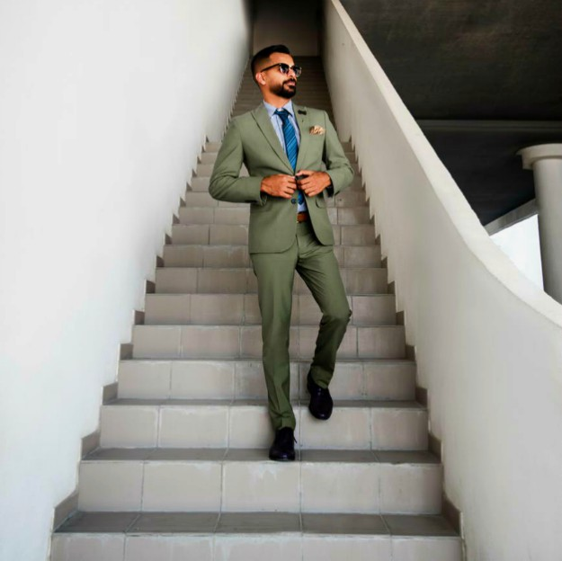 man in grey suit standing on stair | How To Set Yourself Up For Success