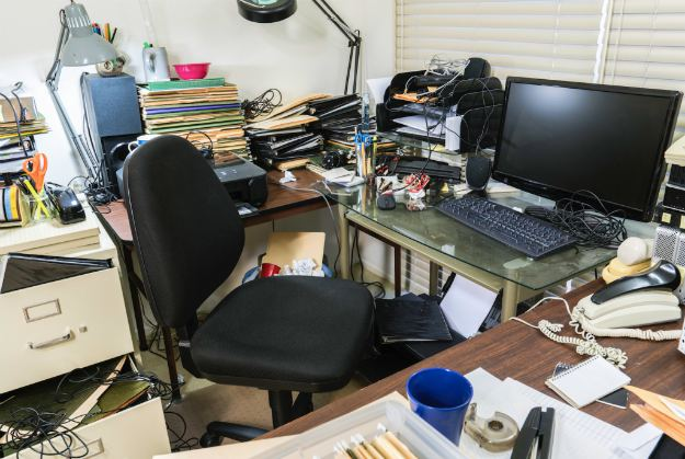 messy business office desk piles files | Productivity Tips Every Commercial Real Estate Broker Should Follow | productivity tips