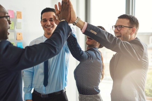 happy successful multiracial business team giving | How People Working Together Can Benefit the Business | teamwork in the workplace