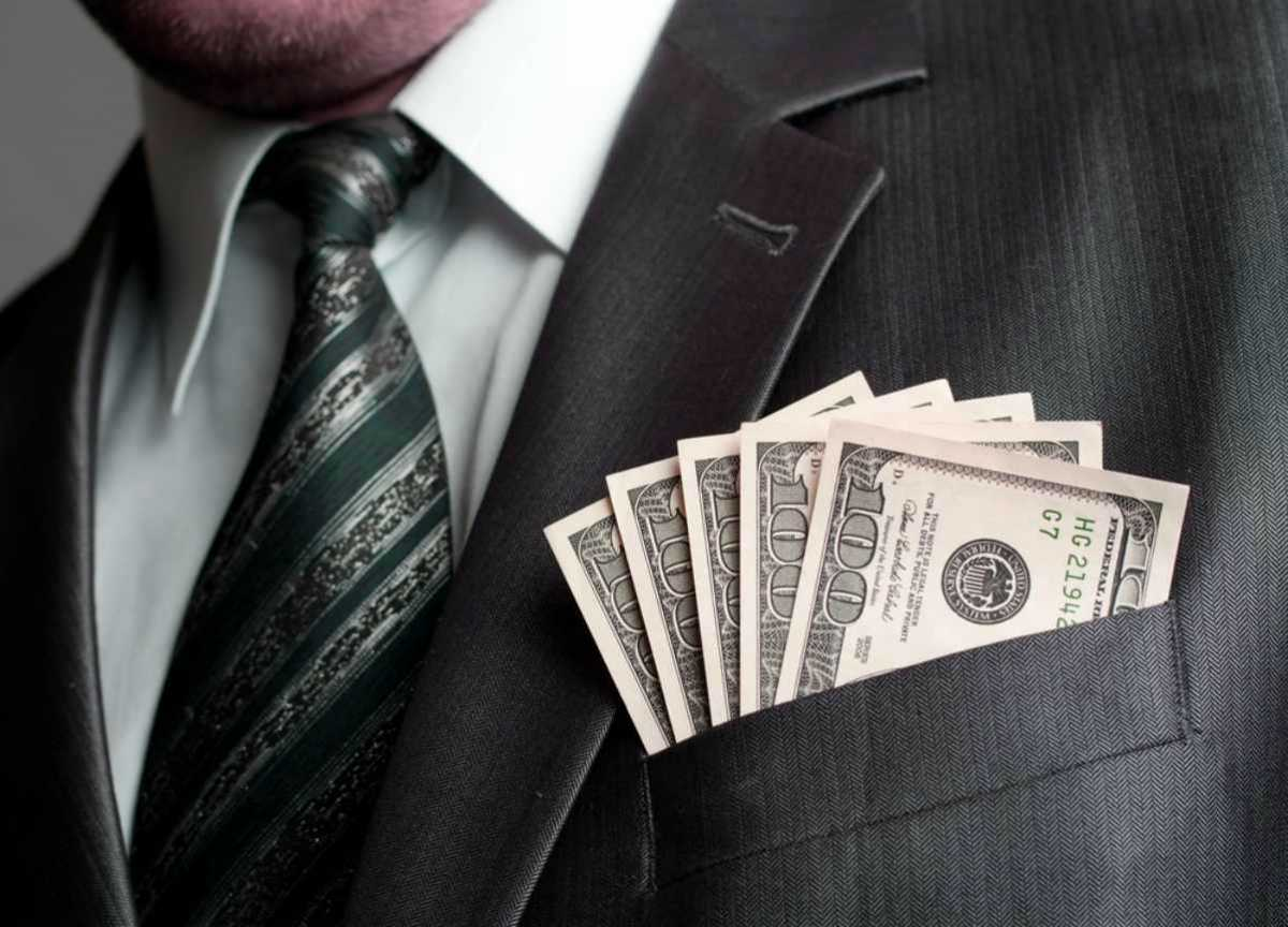 formal wear businessman earned money suit pocket | Biggest Reasons People Pursue Commercial Real Estate Careers | starting a career in commercial real estate