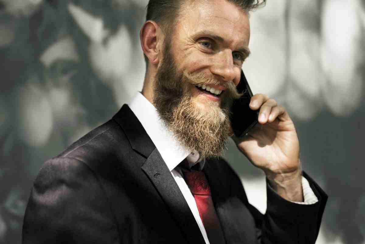 Smiling businessman on a phone | Biggest Mistakes Brokers Make When Cold Calling | brokers calls